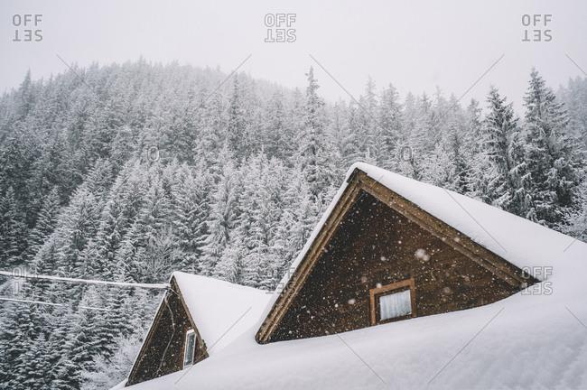 Mountain cabins snowy landscape.