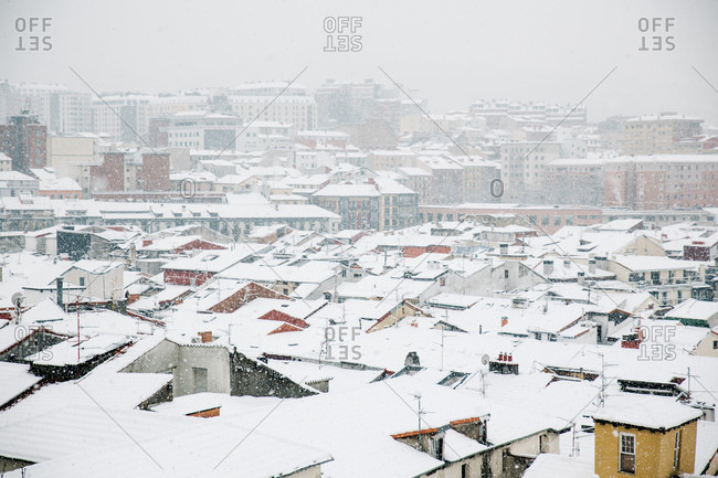 Aerial view to snowy roofs in town