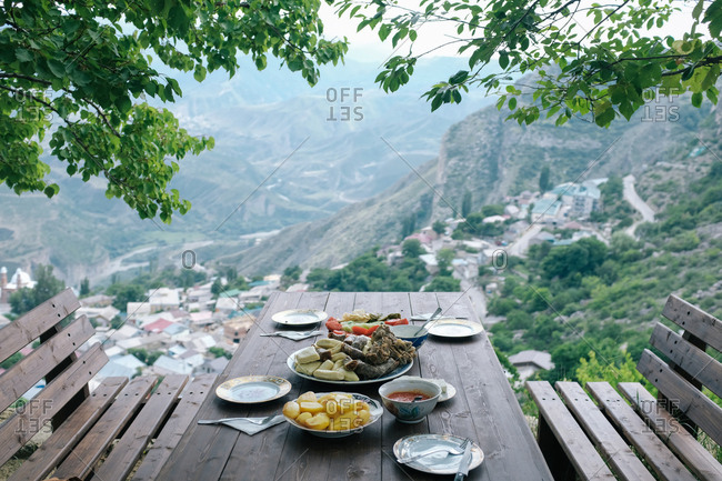 Mountainside picnic table set with dinner