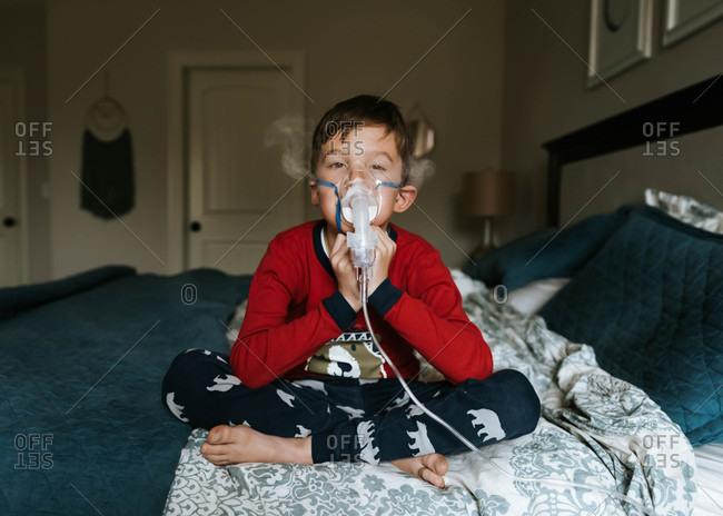 Boy using nebulizer treatment