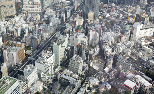 Tokyo, Japan - November 23, 2015: Tokyo city center with businesses and apartment buildings