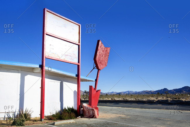 Old sign on a closed business in Twenty-nine Palms, California