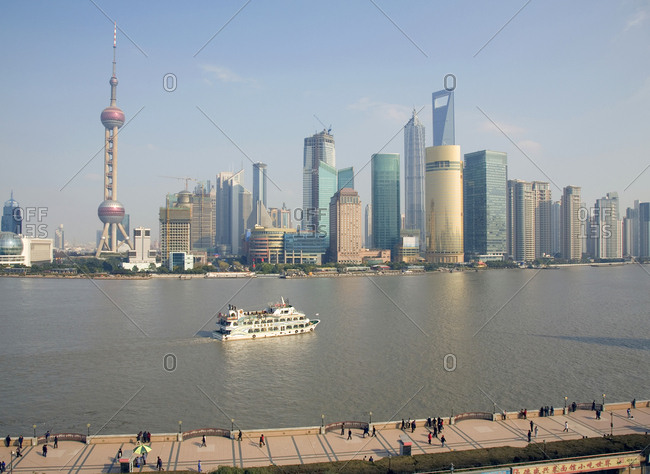 Shanghai, China - December 12, 2008: Pudong business district during daylight and the Huangpu River and tour boat