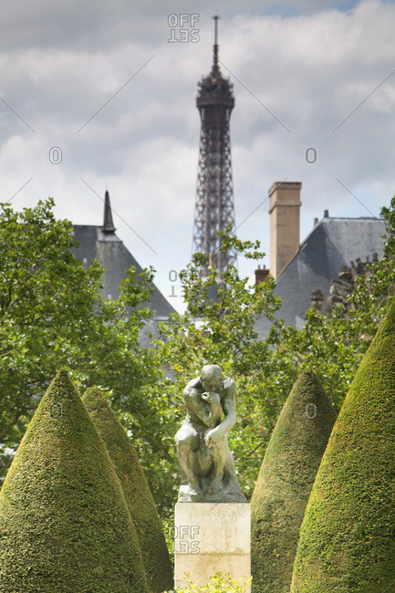 Paris, France - July 14, 2009: Eiffel tower background and Rodin's thinker in foreground