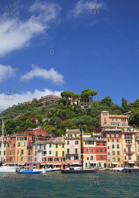 Portofino, Italy - January 29, 2010: Colorful hillside buildings along the harbor in Portofino