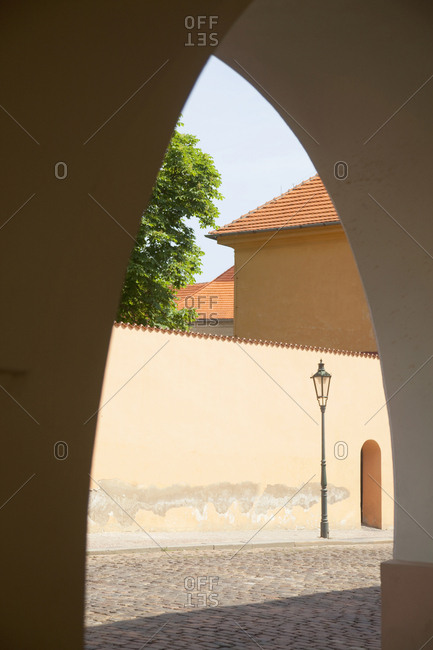View through arch in old town, Prague, Czech Republic