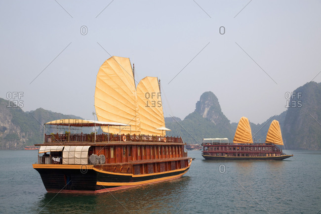 Tourist junks with sails up, Halong Bay, Hanoi, Vietnam