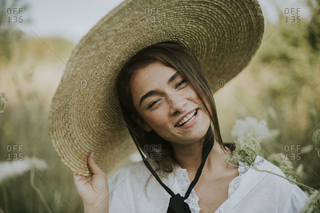 Pretty woman in a flower field