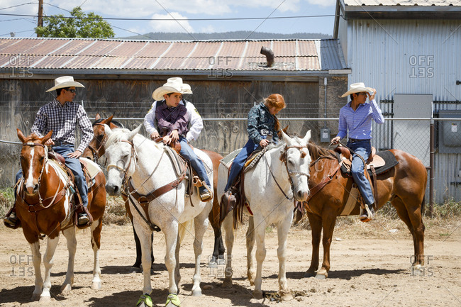 Taos, New Mexico, USA - June 18, 2018: People on horses at small town rodeo