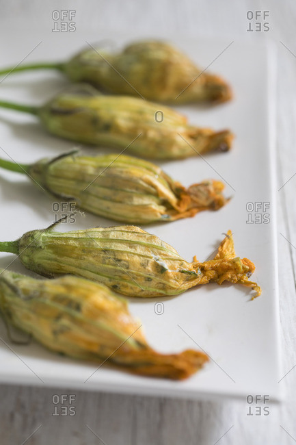 Stuffed squash blossoms on plate