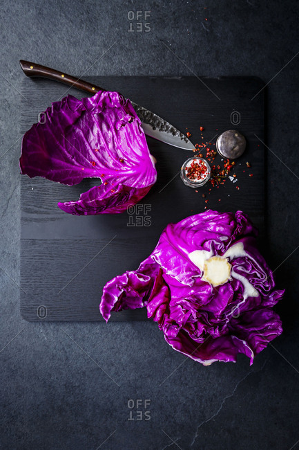 Raw red cabbage with bright red chili flakes and salt