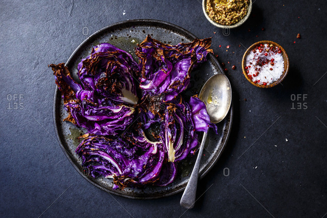 A plate of roasted red cabbage with mustard