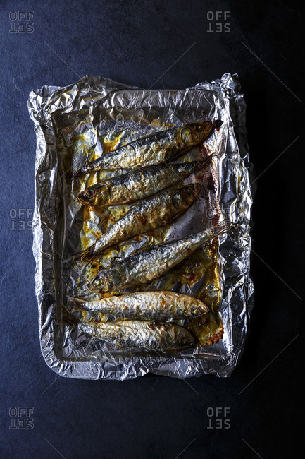 Roasted sardine fillets on roasting tray