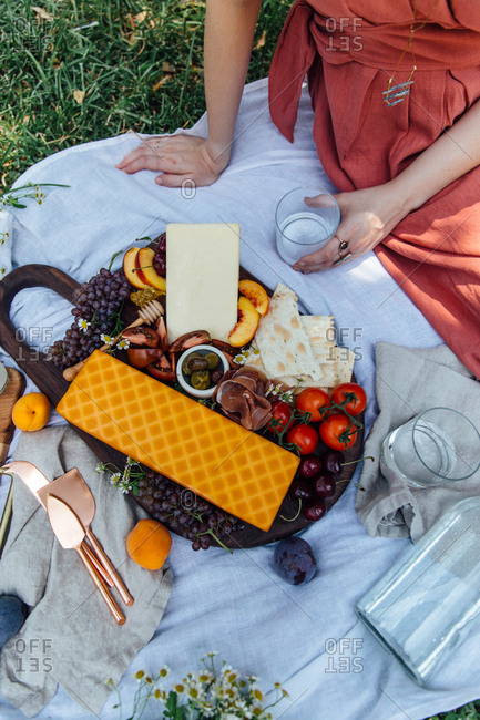 Summer charcuterie board picnic with woman