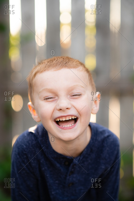 Portrait of a laughing boy outdoors