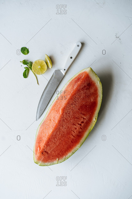 Overhead view of a sliced watermelon on white background