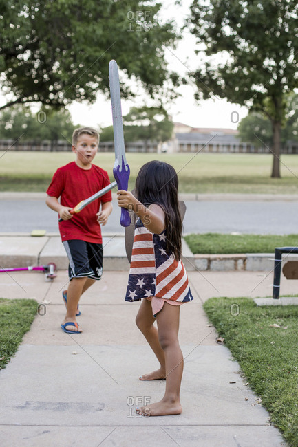 Children pretending to have a sword fight