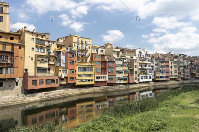 July 2, 2018: Spain- Girona- row of houses at the riverside