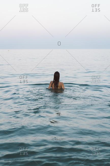 Beautiful woman at the beach- swimming in the sea