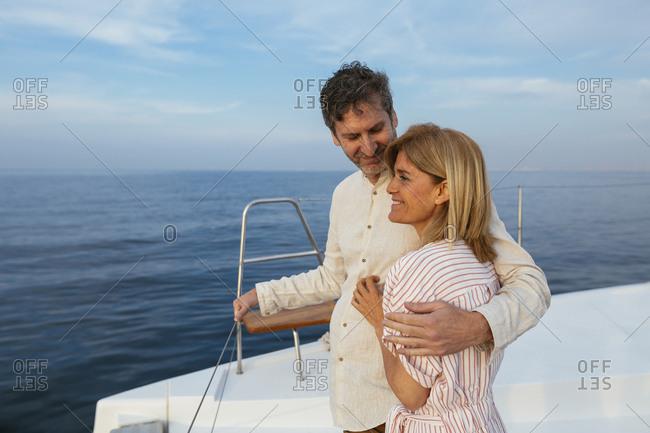 Mature couple enjoying quality time on sailing trip on a catamaran
