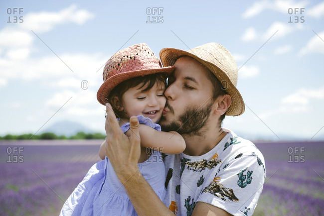 France- Provence- Valensole plateau- father kissing daughter in lavender fields in the summer