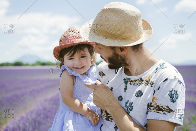 France- Provence- Valensole plateau- happy father and daughter in lavender fields in the summer