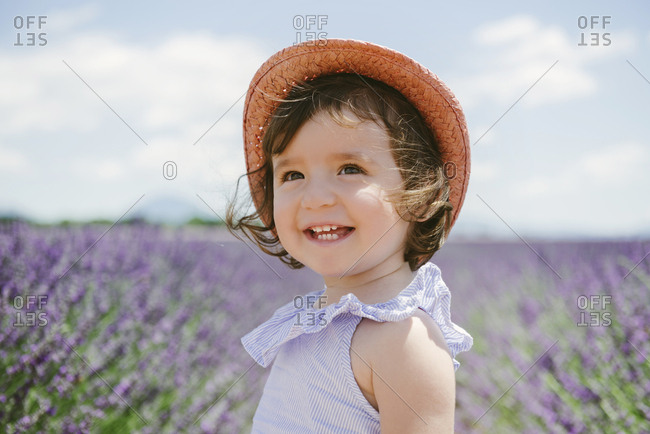 France- Provence- Valensole plateau- Happy toddler girl in purple lavender fields in the summer