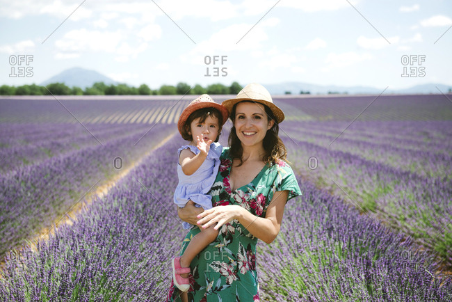 France- Provence- Valensole plateau- portrait of smiling mother and daughter in lavender fields in the summer