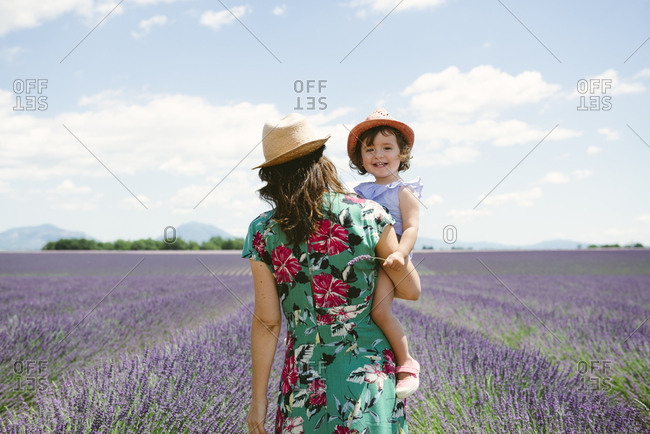 France- Provence- Valensole plateau- Mother and daughter walking among lavender fields in the summer