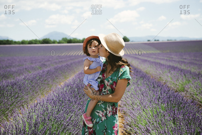 France- Provence- Valensole plateau- Mother kissing daughter in lavender fields in the summer