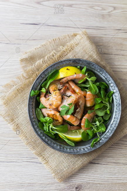 Shrimps with lamb's lettuce on plate