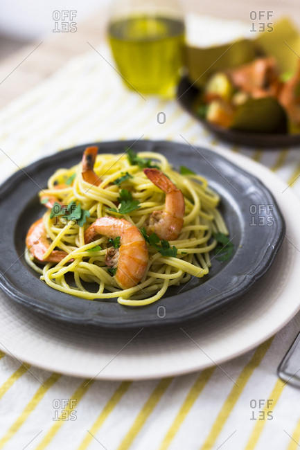Shrimps with spaghetti on tin plate