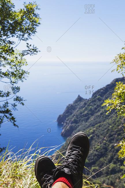 Italy- Liguria- Portofino Peninsula- Hiker resting in the mountains
