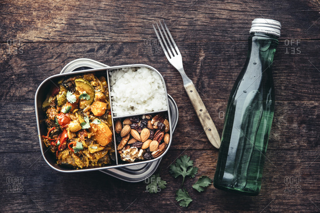 Take Away Food- tamarind vegetable stew- carrot- zucchini- bell pepper- eggplant- onion- tomato and falafel balls- rice and nuts with raisins