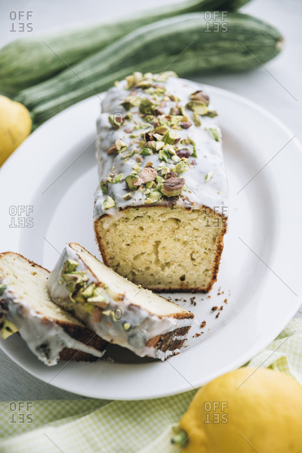 Lemon zucchini cake with lemon icing and pistachio topping