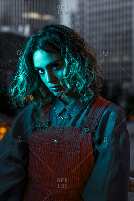 Portrait of a beautiful woman at night- wearing dungarees