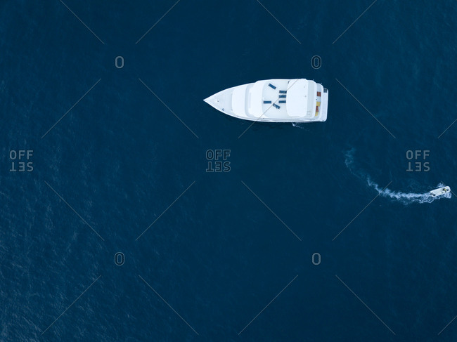 Maldives- Aerial view of yacht and small boat
