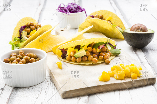 Vegetarian tacos filled with in curcuma roasted chick peas- yellow paprika- avocado- salad and red cabbage