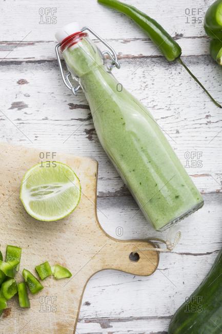 Glass bottle of homemade green Gazpacho