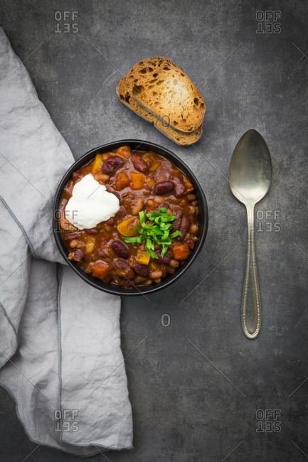 Bowl of Chili con Carne with fresh coriander and sour cream