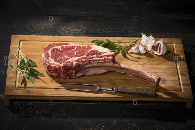 Raw tomahawk steak- garlic and herbs