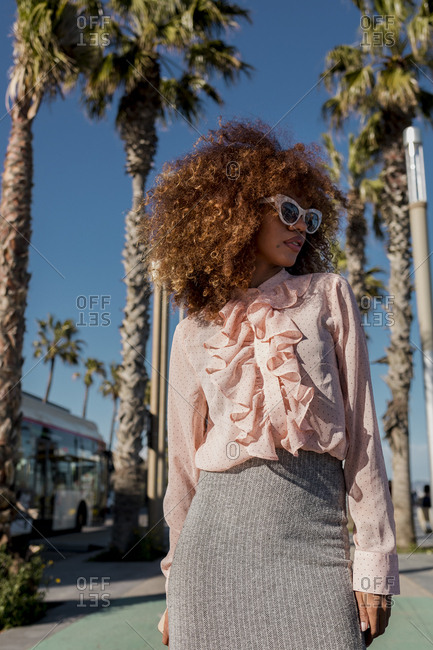 Portrait of stylish young woman at seaside promenade