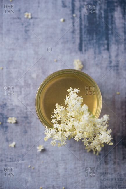 Glass of elderflower syrup