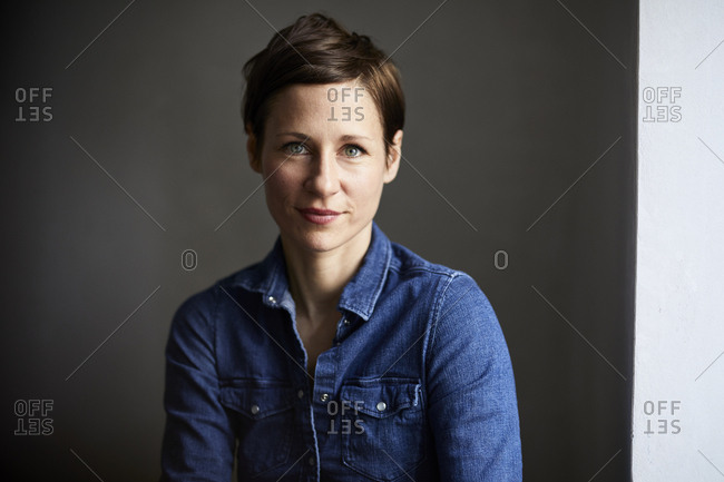Portrait of an attractive woman- wearing denim shirt