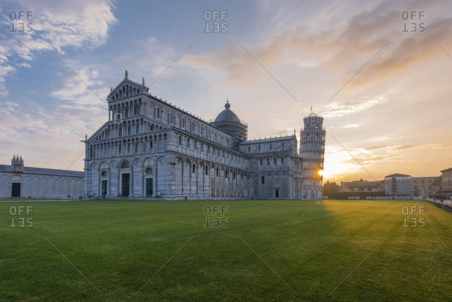 Italy- Tuscany- Pisa- View to Pisa Cathedral and Leaning Tower of Pisa from Piazza dei Miracoli at sunset