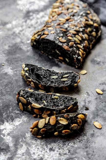 Black sepia spelt bread with pumpkin seeds