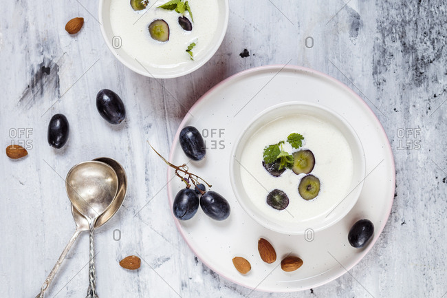 Ajo Blanco- white gazpacho- spanish cold soup- almonds and blue grapes- overhead view