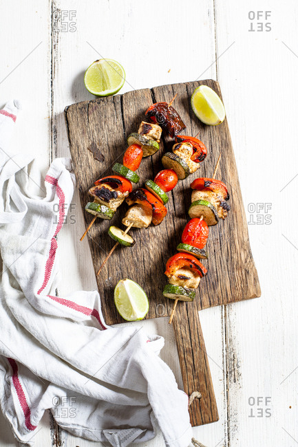 Grill skewers with grilled chicken- tomato- bell pepper and zucchini on chopping board