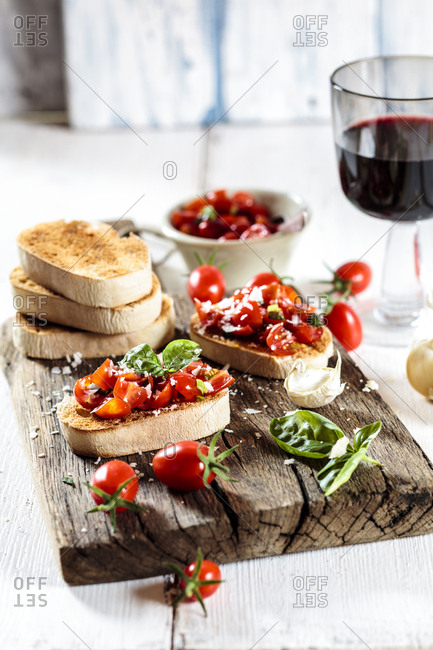 Italian buschetta and glass of red wine