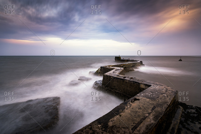 UK- Scotland- Fife- St Monans- breakwater at stormy day- long exposure